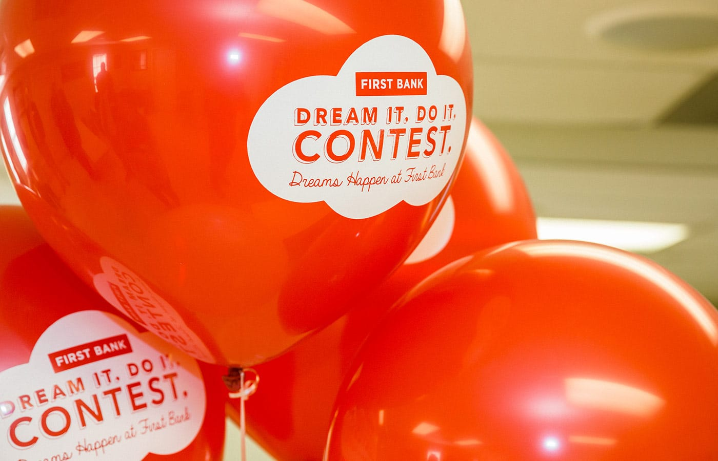 Red balloons with the contest logo on them.