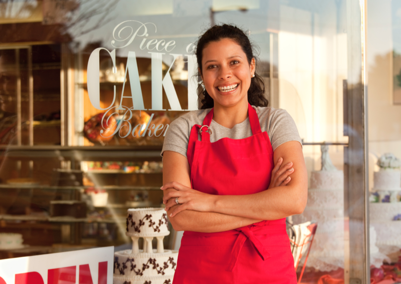business woman in front of bakery